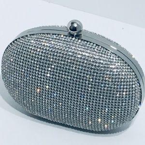 Handbags - Similar embellished Clutch.